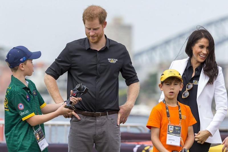 The couple played with children and remote control cars during the challenege (EPA)