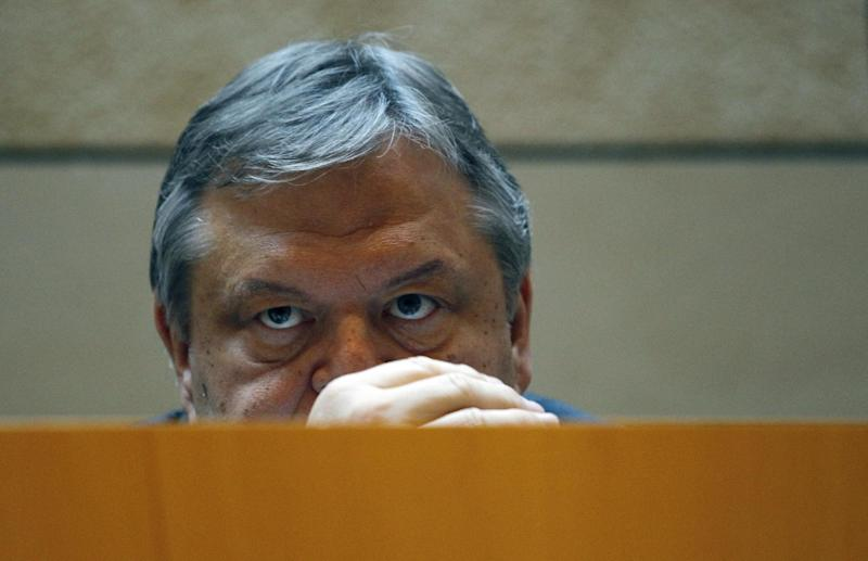 In this image taken in Athens on Aug. 2 2011 Greek Sosialist leader Evangelos Venizelos listen to a speech by Organization for Economic Co-operation and Development Secretary General Angel Gurria. Venizelos has worn many hats during the Greek crisis: point man in talks on an international bailout agreement when he was finance minister in a previous government, inheritor of a once-dominant political force whose popularity crumbled under voter fury at austerity measures, and now, possibly, kingmaker in post-election efforts to form a ruling coalition from Greece's fractious political groups. (AP Photo/Dimitri Messinis)