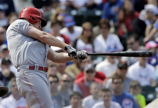 Cincinnati Reds' Jay Bruce hits an one-run single against the Chicago Cubs during the eighth inning of a baseball game in Chicago, Saturday, May 4, 2013. The Reds won 6-4. (AP Photo/Nam Y. Huh)