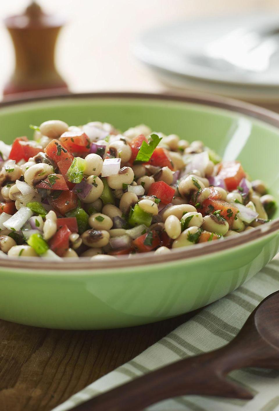 """<p>This New Year's Eve staple is a colorful display of goodness. </p><p><strong><a href=""""https://www.countryliving.com/recipefinder/black-eyed-pea-salad"""" rel=""""nofollow noopener"""" target=""""_blank"""" data-ylk=""""slk:Get the recipe"""" class=""""link rapid-noclick-resp"""">Get the recipe</a>.</strong></p>"""