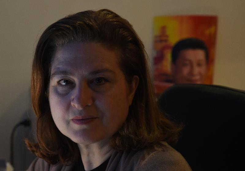 Beijing refused to renew the credentials of Ursula Gauthier, the China correspondent for France's L'Obs news magazine, after she wrote an article questioning Beijing's policy in Xinjiang (AFP Photo/Greg Baker)