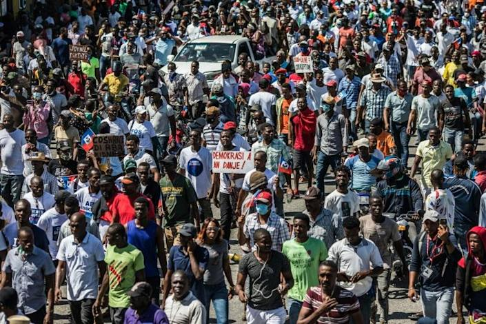 Several thousand people demonstrate in the Haitian capital Port-au-Prince, saying the government is trying to establish a new dictatorship and denouncing international support for President Jovenel Moise