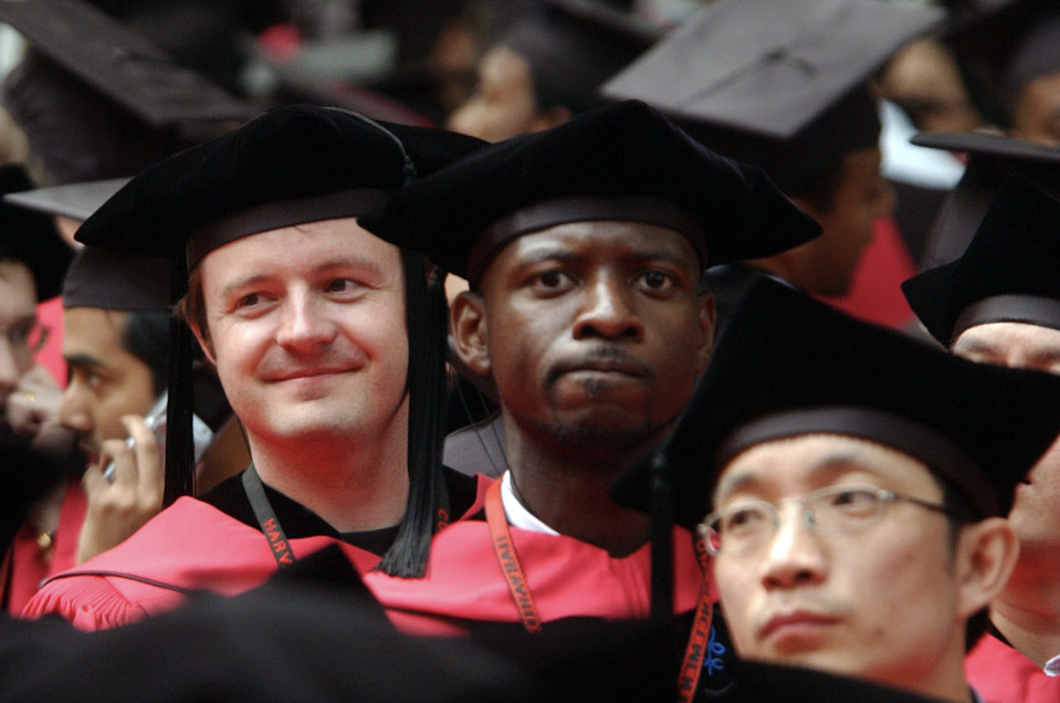 Harvard University students listen as commencement ceremonies wrap up at Harvard University June 7, 2007 in Cambridge, Massachusetts. Microsoft co-founder and Chairman Bill Gates, who enrolled at Harvard in a pre-law program in 1973 and left in his junior year, received an honorary Doctor of Laws degree. (Photo: Getty)