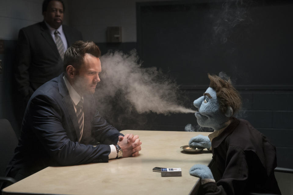 """This image released by STX Entertainment shows Joel McHale in a scene from """"The Happytime Murders."""" (Hopper Stone/STX Entertainment via AP)"""