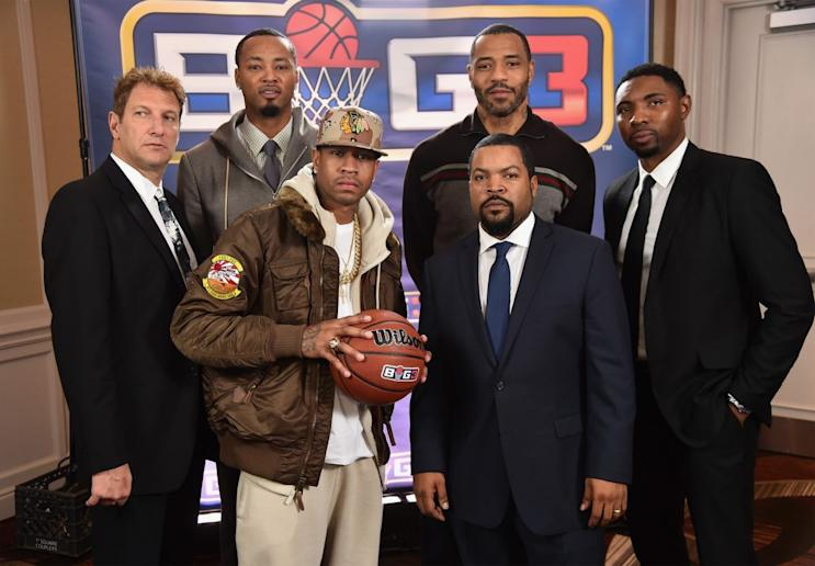 Allen Iverson and Ice Cube have their game faces on. (Getty Images)