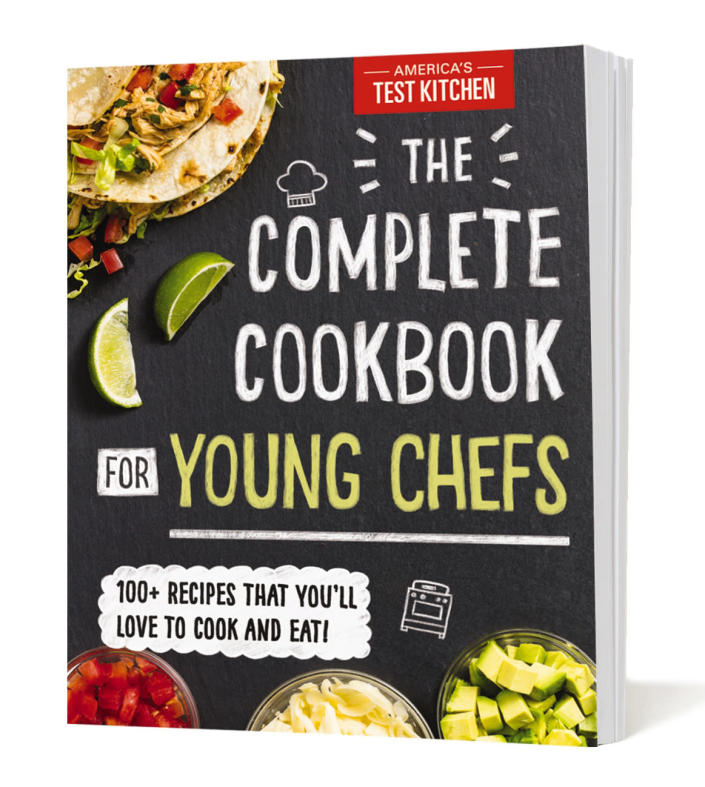 """This image provided by America's Test Kitchen in February 2019 shows the cover for """"The Complete Cookbook for Young Chefs."""" It includes a recipe for ham and cheese sliders. (America's Test Kitchen via AP)"""