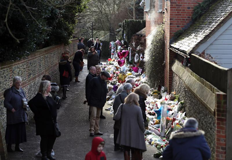 Members of the public view floral tributes outside the home of George Michael in Goring-on-Thames, Oxfordshire, after he died on Christmas Day aged 53.