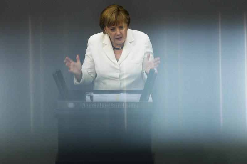 German Chancellor Angela Merkel addresses lawmakers on the decisions of the EU summit at the parliament Bundestag in Berlin, Friday, June 29, 2012. Chancellor Merkel faces a vote on the eurozone's new permanent rescue fund and the EU's fiscal pact. In front of her are reflections from a balcony board. (AP Photo/Markus Schreiber)