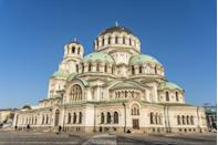 <p>Alexander Nevsky Cathedral is one of the largest Eastern Orthodox churches in the world and is one of Bulgaria's most popular tourist attractions. The cathedral was named after a Russian prince and honors Russian soldiers who died in the Russo-Turkish War of 1877, after which Bulgaria was freed from Ottoman rule. The cathedral was complete in 1912, with its name being temporarily changed shortly after, due to Russia and Bulgaria belonging to opposing alliances during WWI, but its original name was reinstated in 1920.</p><p>What makes this structure so unique is that it's comprised of pieces from across Europe. Its marble parts and light fixtures were made in Munich, metal elements in Berlin, and its gates and mosaics in Venice. </p>