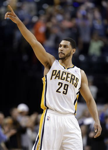 Indiana Pacers forward Jeff Pendergraph salutes the fans following the Pacers' 99-94 win over Cleveland Cavaliers in an NBA basketball game in Indianapolis, Tuesday, April 9, 2013. (AP Photo/Michael Conroy)