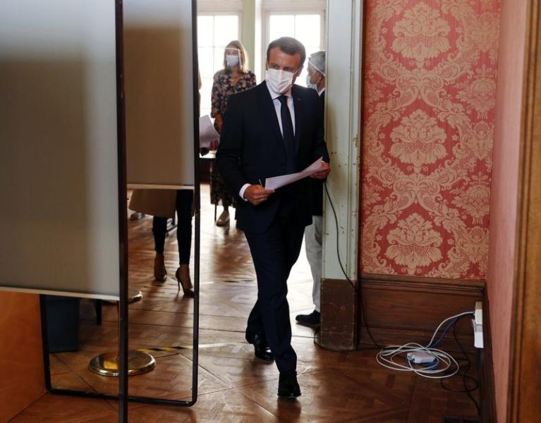French President Macron votes in second round of French municipal elections, in Le Touquet