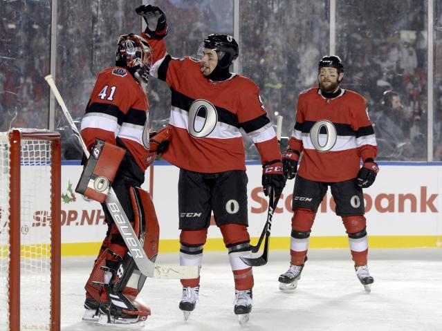 <p>Teammates congratulate Craig Anderson after he posts a shutout in the NHL 100 Classic to give the Senators their second straight win after a very tumultuous few weeks. </p>
