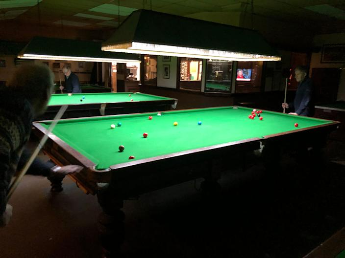Ian Day, far left, and Syl Goldberg, far right, play a game of snooker at the Romford Snooker Club, outside of London on Feb. 4, 2019.