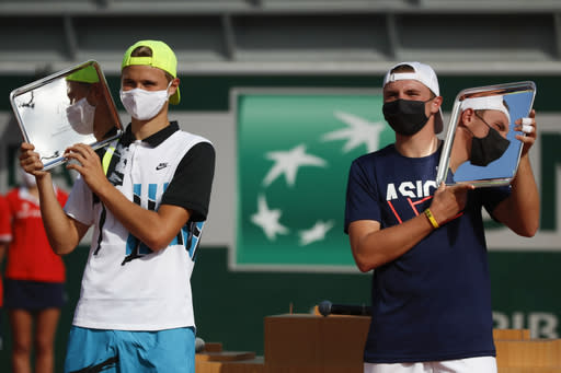 The Latest: Stricker wins French Open boys' title