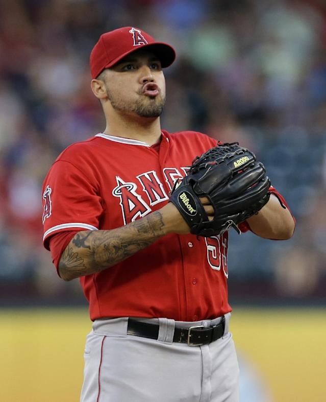 Los Angeles Angels' Hector Santiago takes a deep breath before working against the Texas Rangers in the first inning of a baseball game, Thursday, July 10, 2014, in Arlington, Texas. (AP Photo/Tony Gutierrez)