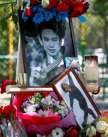Candles, flowers, and photos of the assassinated Kazakhstan's Olympic figure skater Denis Ten are seen at the makeshift memorial in Almaty, Kazakhstan July 20, 2018. REUTERS/Shamil Zhumatov