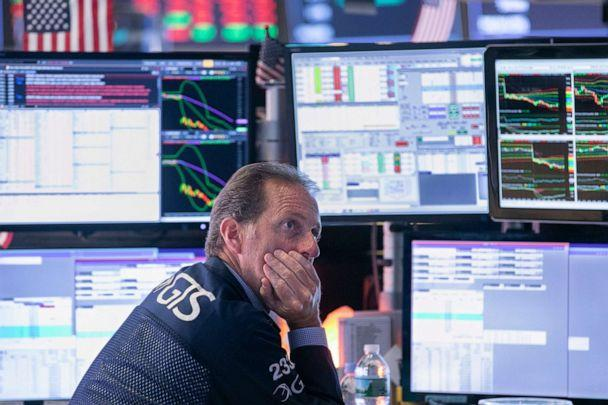 PHOTO: Specialist Glenn Carrel works at his post on the floor of the New York Stock Exchange, Aug. 14, 2019. (Richard Drew/AP)