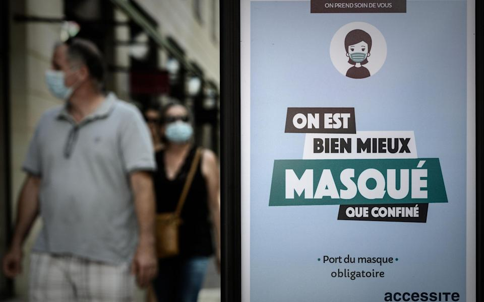 A sign instructs people to wear face masks in Bordeaux - Getty
