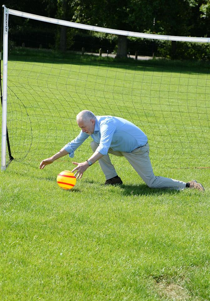 <p>Jeremy Corbyn saved a penalty kick from a child during a visit to Hackney Marshes Football Pitches (PA Images) </p>
