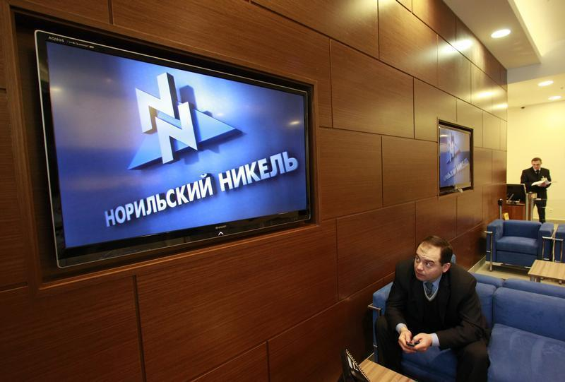 A man sits in the reception room of the office of Norilsk Nickel company in Moscow