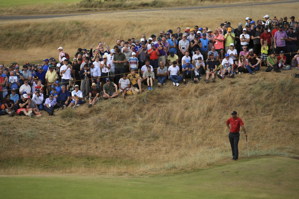 Tiger Woods waits to putt during the final round of the British Open Golf Championship in Carnoustie, Scotland, (AP)