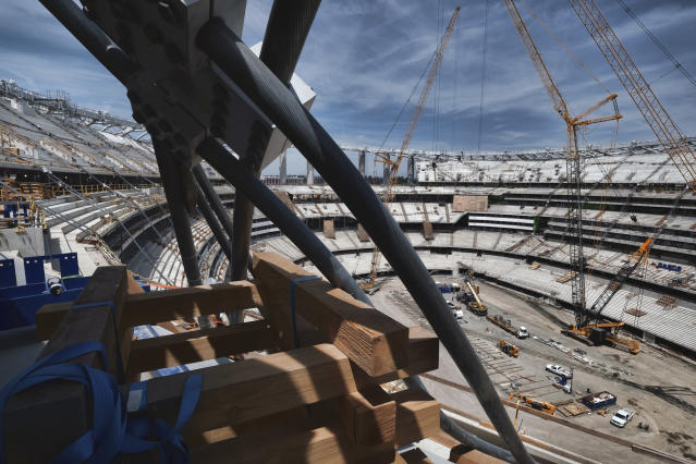 An arresting cable used for the canopy hangs over the side of the new NFL football Los Angeles Stadium under construction in Inglewood, Calif. on Monday April 15, 2019. Stadium officials hosted a tour for the media after the final piece of the canopy structure to hold the roof was completed. (AP Photo/Richard Vogel)