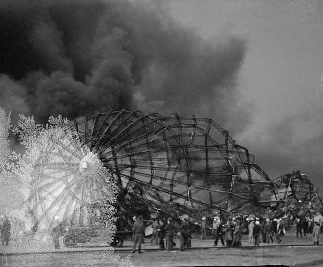 <p>Clouds of smoke rise from the twisted metal frame of the German airship Hindenburg as rescue workers arrive to look for possible survivors, May 6, 1937, in Lakehurst, N.J. The Hindenburg exploded as it was mooring at the Lakehurst Naval Air Station. (AP Photo) </p>