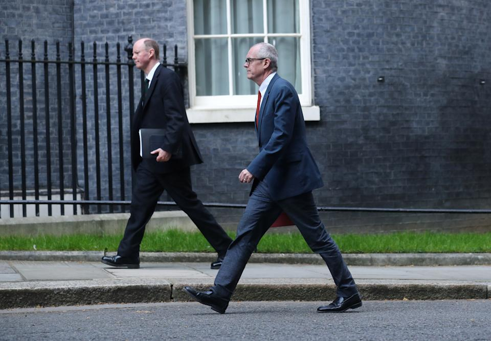 Chief Medical Officer for England, Chris Whitty and UK Government Chief Scientific Adviser Sir Patrick Vallance arrive on Downing Street after British Prime Minister Boris Johnson was moved to intensive care as his coronavirus (COVID-19) symptoms worsened and Secretary of State for Foreign affairs Dominic Raab was asked to deputise, London, Britain, April 7, 2020. REUTERS/Simon Dawson