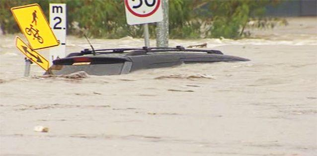 Cars underwater in storms that battered QLD yesterday as flood warnings are put in place for NSW. Photo: 7News