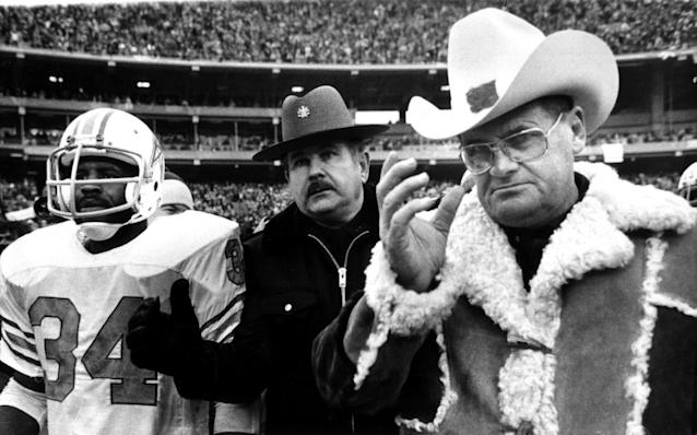 FILE - In this Jan. 6, 1980, file photo, Houston Oilers coach Bum Phillips and running back Earl Campbell (34) leave field after the Oilers' loss to the Pittsburgh Steelers in the AFC championship NFL football tame in Pittsburgh. Phillips, the folksy Texas football icon who coached the Oilers and New Orleans Saints, died Friday, Oct. 18, 2013. He was 90. (AP Photo/ File)