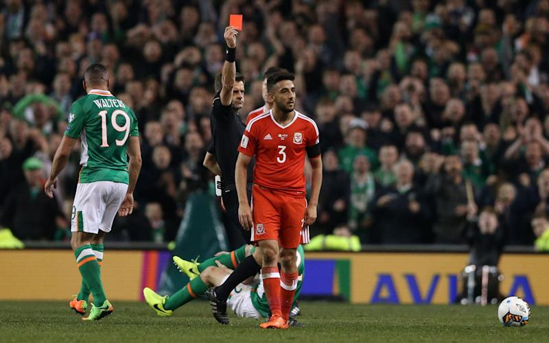 Neil Taylor is sent off for a reckless tackle on Ireland's captain Seamus Coleman - PA