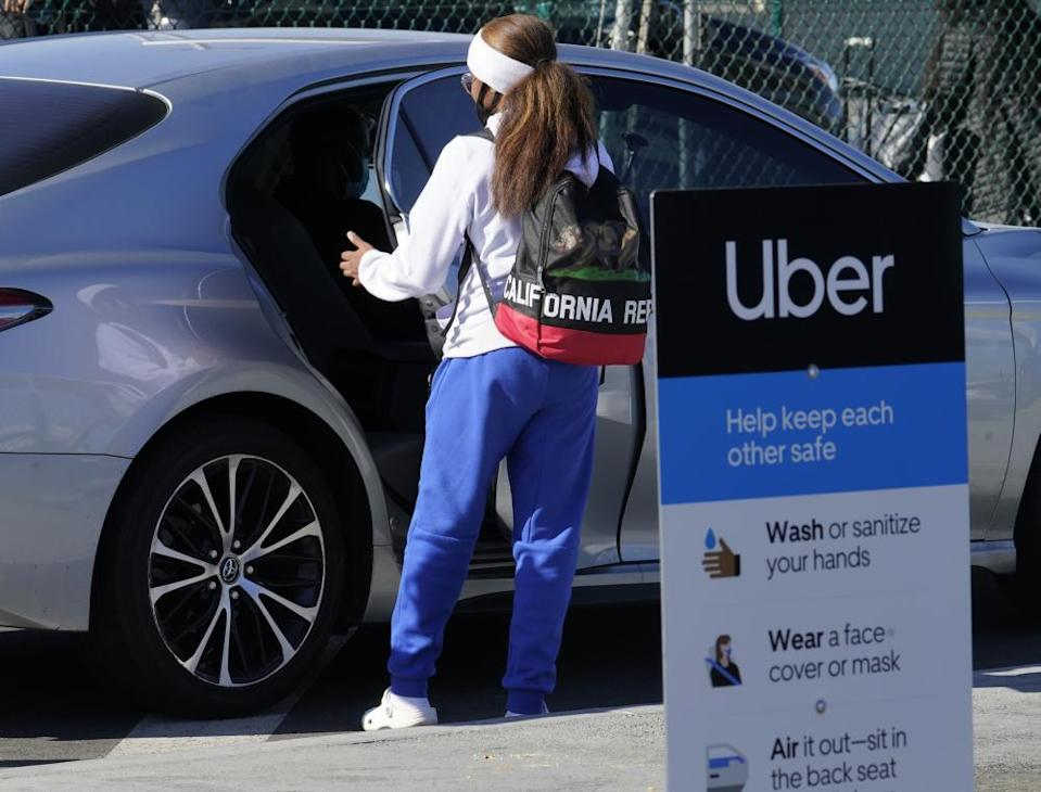 An Uber ride at Los Angeles international airport. Rideshare drivers fear for their safety amid Covid.