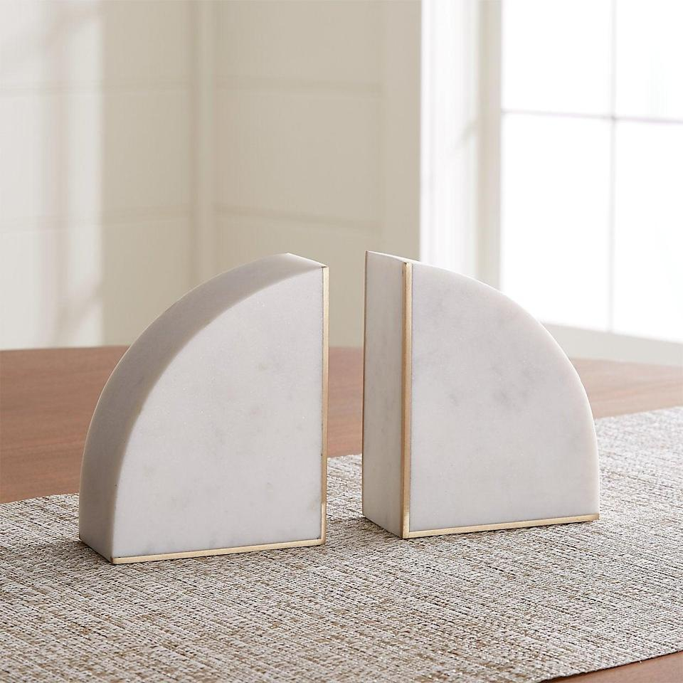 "<h2>White Marble Bookends</h2><br>Fancy, but make it functional. <br><br><strong>Crate and Barrel</strong> White Marble Bookends, $, available at <a href=""https://go.skimresources.com/?id=30283X879131&url=https%3A%2F%2Fwww.crateandbarrel.com%2Fwhite-marble-bookends-set-of-2%2Fs600794"" rel=""nofollow noopener"" target=""_blank"" data-ylk=""slk:Crate and Barrel"" class=""link rapid-noclick-resp"">Crate and Barrel</a>"