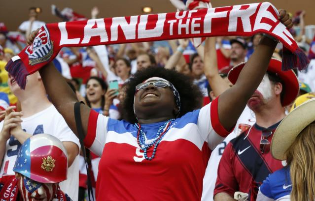 A U.S. fan holds a scarf during the 2014 World Cup G soccer match between Portugal and the U.S. at the Amazonia arena in Manaus June 22, 2014. REUTERS/Siphiwe Sibeko (BRAZIL - Tags: SOCCER SPORT WORLD CUP)