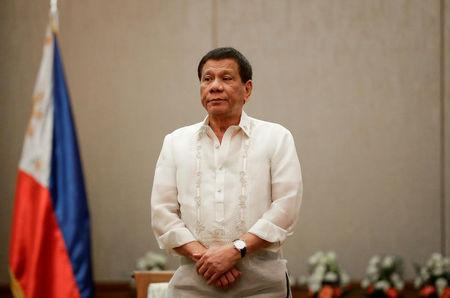 Philippines 'President Rodrigo Duterte stands at attention during a courtesy call with the Association of Southeast Asian Nations (ASEAN) Economic Ministers in Manila