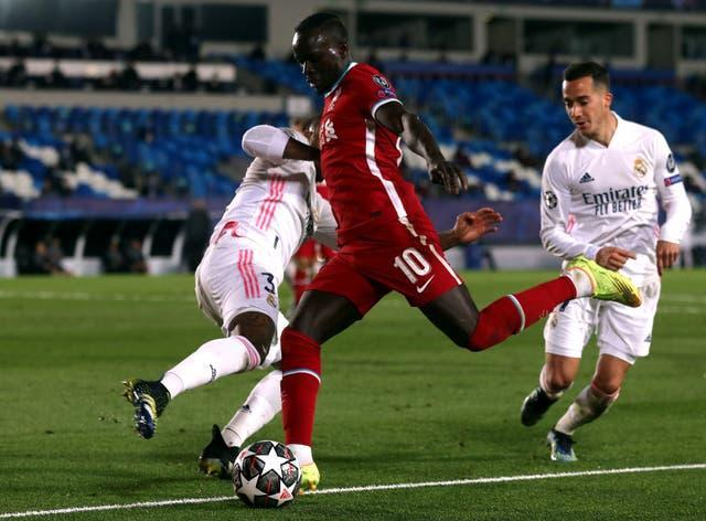 Mane (pictured, centre), Alexander-Arnold and Keita all played in Tuesday's loss to Real Madrid (Isabel Infantes/PA).