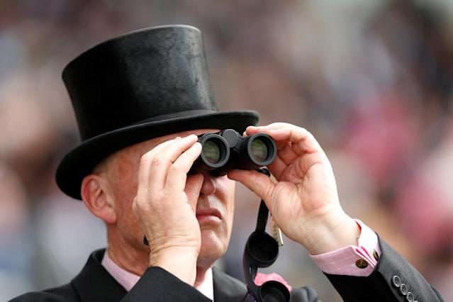 Horse Racing - Royal Ascot - Ascot Racecourse, Ascot, Britain - June 19, 2018 Racegoer looks through Binoculars Action Images via Reuters/Andrew Boyers