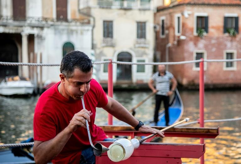 Showing off Murano glassmaking on Venice's Grand Canal
