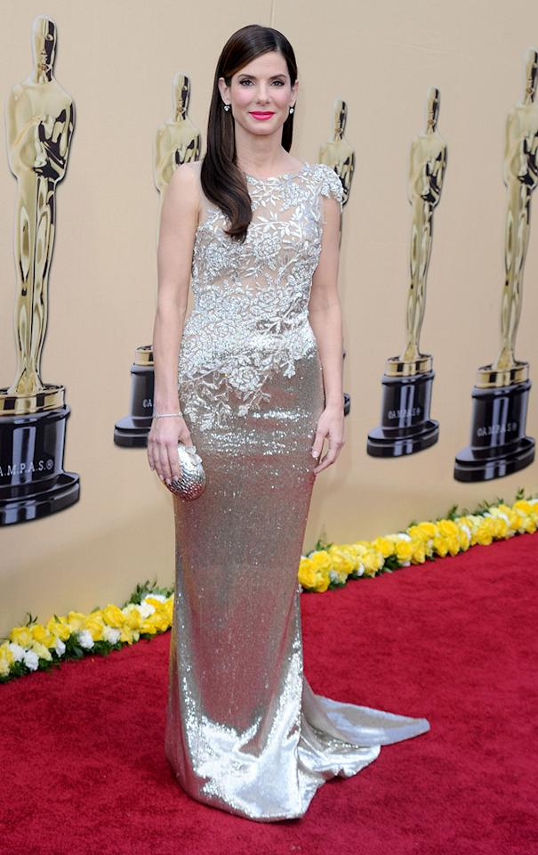 Sandra Bullock   Grade: A-    The Best Actress winner channeled Old Hollywood in an embroidered lace and metallic Marchesa sheath, which was perfect for showcasing her golden Oscar statuette.