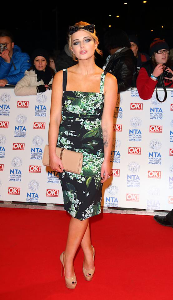 Helen Flanagan's green floral dress seemed to be inspired by her time in the jungle. Copyright [getty]