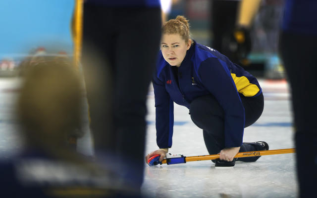 Sweden's skip Margaretha Sigfridsson watches the rock during the women's curling competition against Great Britain at the 2014 Winter Olympics, Monday, Feb. 10, 2014, in Sochi, Russia. (AP Photo/Wong Maye-E)