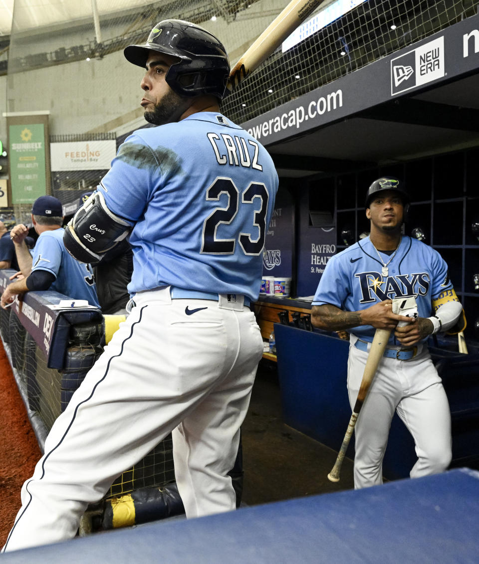 Tampa Bay Rays' Nelson Cruz (23) and Wander Franco get ready to bat against the Miami Marlins during the first inning of a baseball game Sunday, Sept. 26, 2021, in St. Petersburg, Fla. (AP Photo/Steve Nesius)