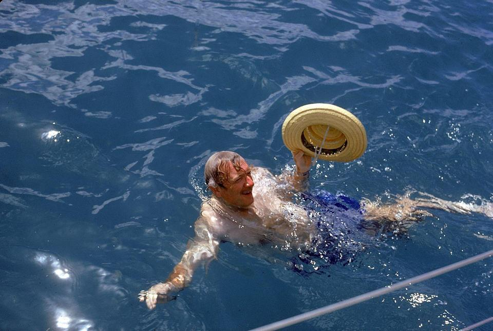 <p>Walter Cronkite swims in the Caribbean Sea in 1971. </p>