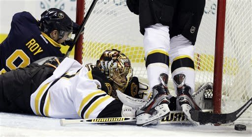 Boston Bruins goalie Tuukka Rask makes a save on a shot by Buffalo Sabres' Derek Roy (9) during the first period of an NHL hockey game in Buffalo, N.Y., Friday, Feb. 24, 2012. (AP Photo/David Duprey)