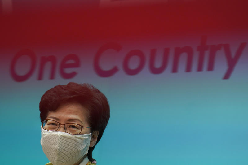 "Hong Kong Chief Executive Carrie Lam listens to reporters' questions during a press conference in Hong Kong, Tuesday, June 2, 2020. Lam hit out at the ""double standards"" of foreign governments over national security, and pointed to recent unrest in America as an example. (AP Photo/Vincent Yu)"