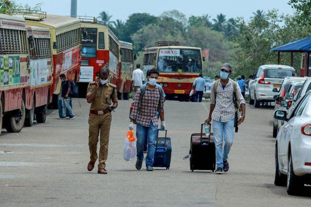 Indian citizens evacuated from Maldives on a special ship being shifted to a quarantine centre by bus in Kochi, Kerala, on May 10, 2020.