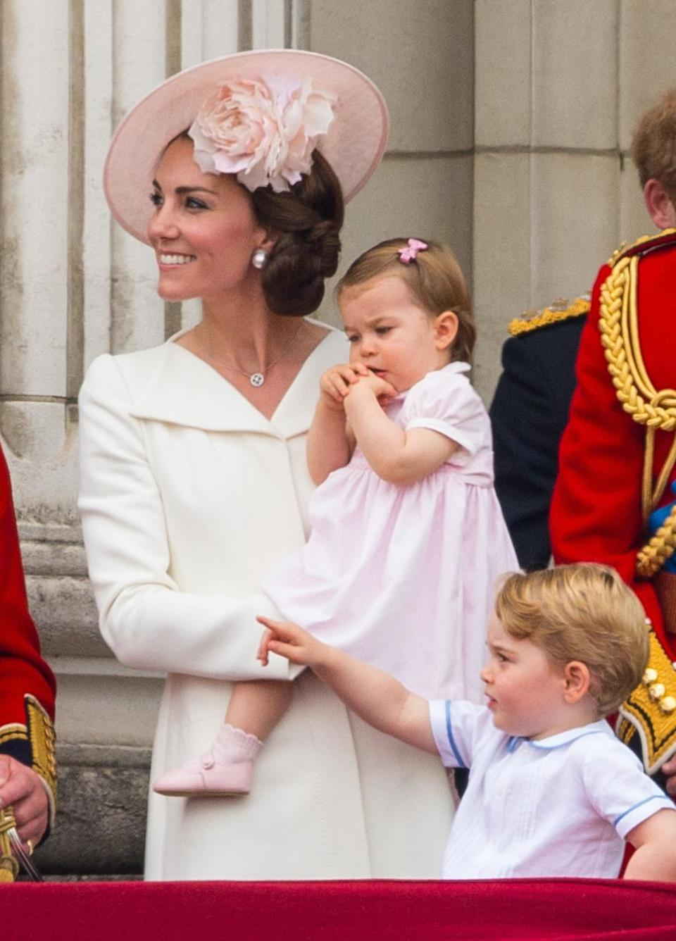 <p>The Duchess recycled her Alexander McQueen outfit from Princess Charlotte's christening for an appearance on the balcony at the Queen's 90th birthday celebration. A pale pink hat by Philip Treacy and pearl Balenciaga earrings completed the look. </p><p><i>[Photo: PA]</i></p>