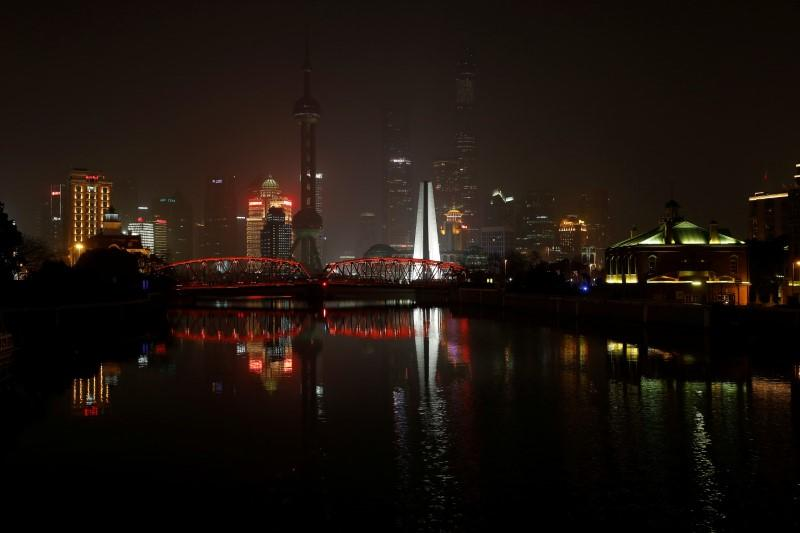 FILE PHOTO - The Bund on the banks of the Huangpu River is pictured during Earth Hour in Shanghai, China March 25, 2017. REUTERS/Aly Song