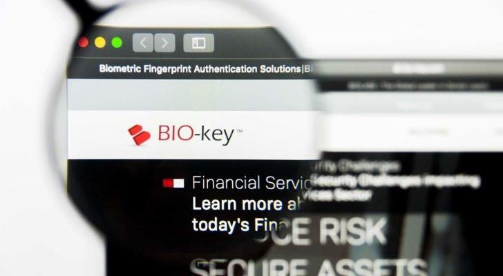 the biokey (bkyi) logo on a webpage under a magnifying glass
