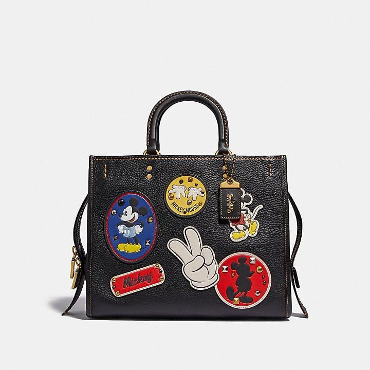<p>This luxe <span>Disney X Coach Rogue With Patches</span> ($895) is for the ultimate Disney fan.</p>